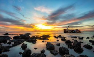 Fishing boat beached with sunset view