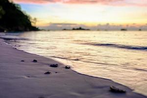 Blur Tilt-shift sunrise at the beach photo