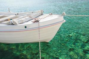 Floating white boat in Kalymnos island bay