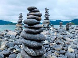 Stacks of pebbles on beach photo