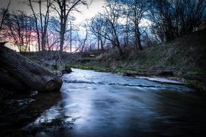 Sunset Over A Stream