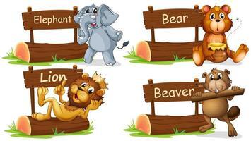 Cuatro animales salvajes con letrero de madera.