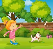 niña jugando con perro mascota en el patio vector