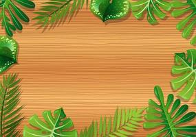Wooden background with tropical foliage