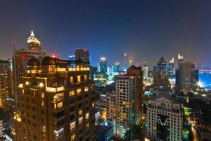 Bright city skyline at night photo