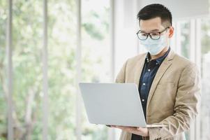 Businessman wearing facemask