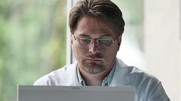 Portrait Of Serious Male Doctor Using Computer In Clinic video