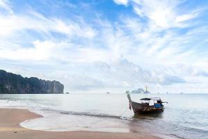 Tropical beach and boat photo