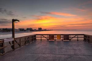 Fort Myers pier at dawn with small light