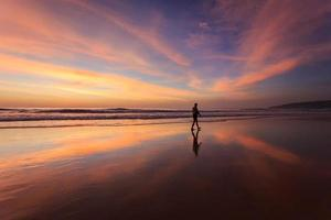 Silhouette of tourist at sunset beach in Phuket Thailand