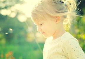 Cute little girl in the sunshine. Back lighting.