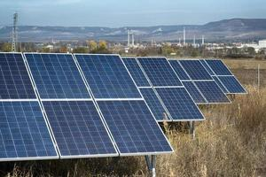 solar cells in front of industrial zone