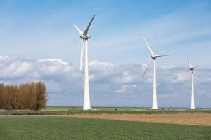 Farmland with wind turbines in the Netherlands photo