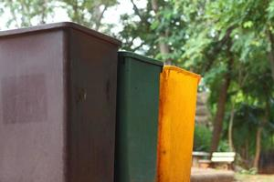Yellow, green, brown bins at the park.
