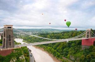 The Clifton Suspension Bridge with several hot air balloons photo