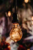 Illuminated light bulb in the dark