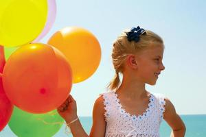 Smiling girl with balloons photo