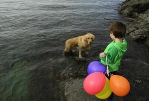 Boy, Balloons and Pet photo