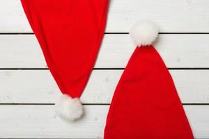 Santa claus hat on wooden background
