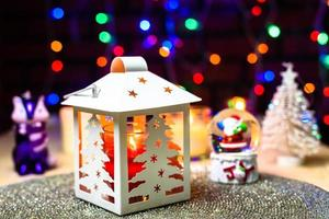 Santa Snow dome and Christmas pine lantern decoration photo
