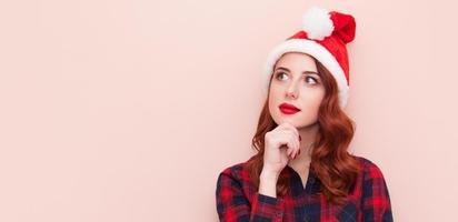 Girl in Santa Claus hat