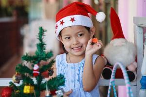 Smile little girl santa hat present have christmas. photo