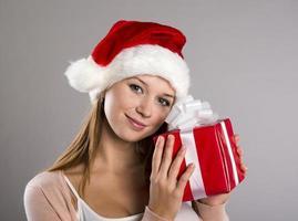 Beautiful christmas woman with gift photo