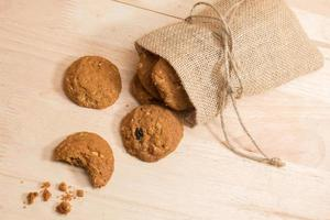 Cookie in woven sack on wood