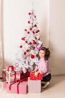 Happy child with Christmas gift box photo