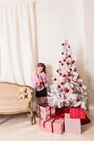 Happy child opening Christmas gift box photo