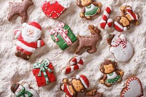 Christmas gingerbread on white flour close-up. Horizontal top vi