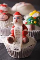 Christmas cupcakes decorated with the figure of Santa macro, ver