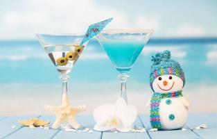 Cocktails with toy snowman against