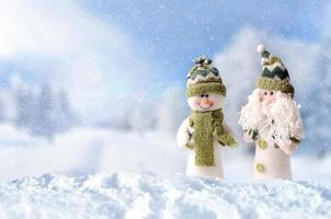 Winter arrival concept with two snowman photo