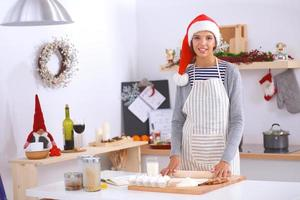 Happy young woman smiling happy having fun with Christmas preparations