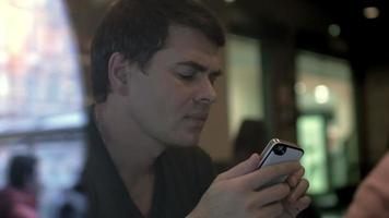 Man Writing Messages in Smartphone video