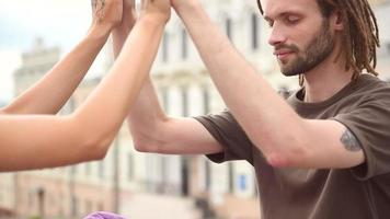 Couple doing yoga for hand together video