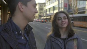 Couple talk at a street corner together video