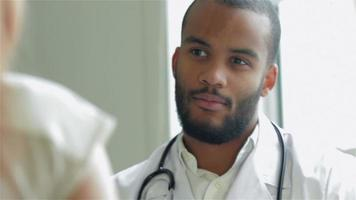 The doctor expresses doubt on the diagnosis of the patient receiving video
