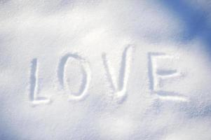 Text LOVE on the snow photo