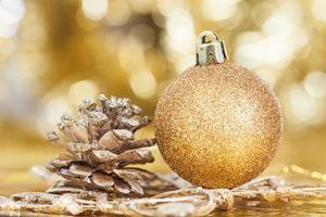 Closeup on decorations: golden christmas ball and cone