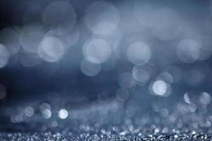 Blue light blurred background texture bokeh drops