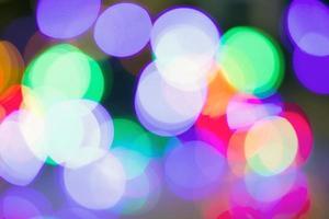 Defocused Bokeh twinkling lights Vintage background. photo