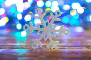 Wooden snowflake on light background
