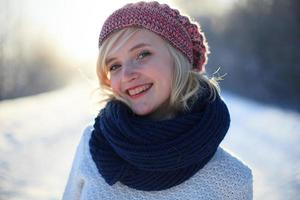 Beautiful sunny portrait of a very cute girl blonde. photo