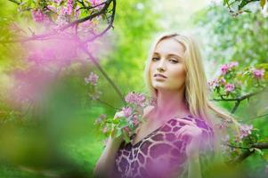 Beautiful woman in the blooming garden