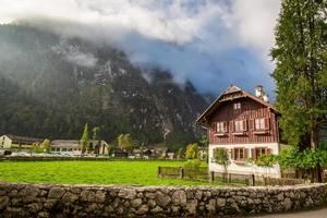 Cottage at the foot of the mountains in the Alps photo