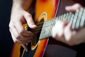 Man playing guitar photo
