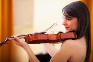 Musician playing her violin photo