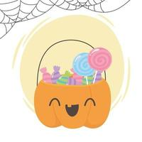 Cute pumpkin shaped basket with candies vector
